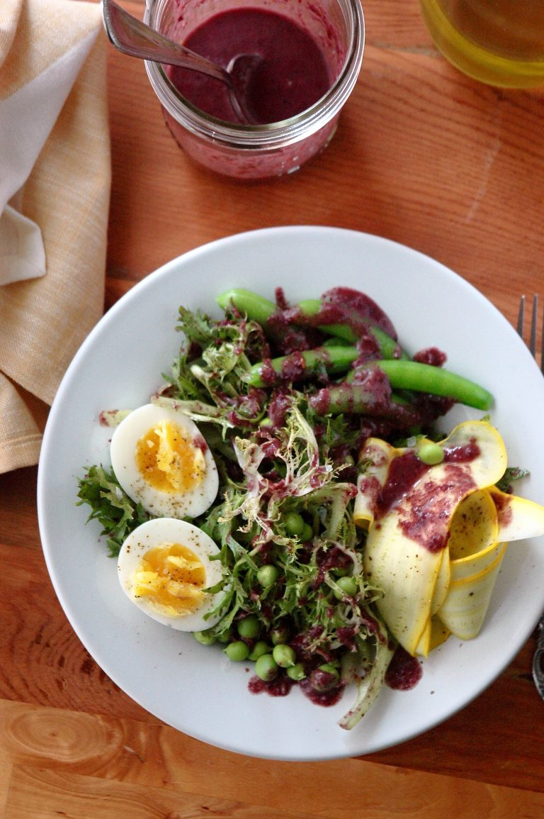 A simple yet satisfying meal-sized salad featuring farm fresh frisée, tender Spring peas, medium-boiled eggs and a uniquely briny, tangy Kalamata olive dressing. Pair with a slice of your favorite fresh bread and enjoy!