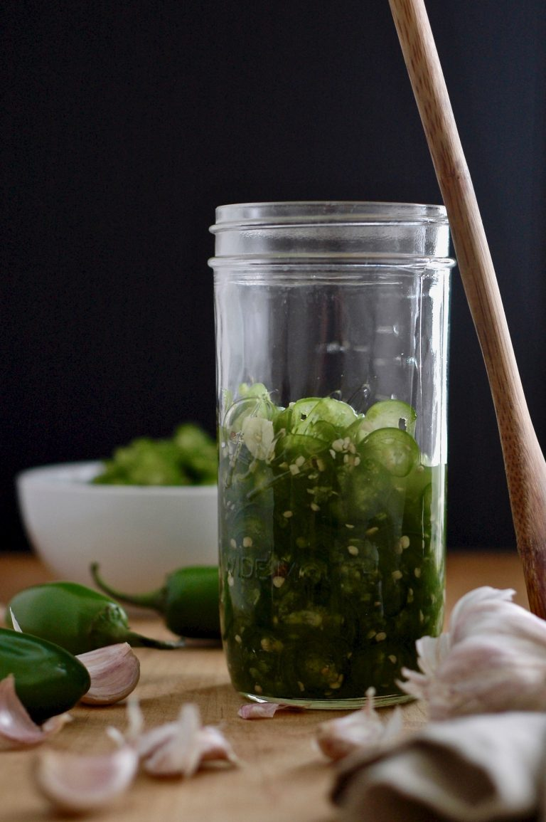 pack jalapeños into a clean, glass jar